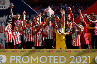 29th May 2021; Wembley Stadium, London, England; English Football League Championship Football, Playoff Final, Brentford FC versus Swansea City; Ethan Pinnock of Brentford lifts the Sky Bet EFL Championship Plays-off Trophy with his team mates after they won 2-0 and promoted to the premier league
