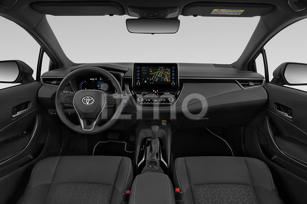 Stock photo of straight dashboard view of 2019 Toyota Corolla-Touring-Sports Hybrid-Style 5 Door Wagon Dashboard