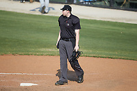 Home plate umpire Mitch Leikam works the South Atlantic League game between the Hickory Crawdads and the Kannapolis Intimidators at Kannapolis Intimidators Stadium on June 2, 2019 in Kannapolis, North Carolina. The Intimidators defeated the Crawdads 4-3. (Brian Westerholt/Four Seam Images)