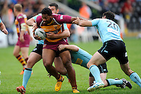 Ukama Ta'ai of Huddersfield Giants forces his way through the London Broncos defence to score a try during the Super League match between Huddersfield Giants and London Broncos at The Twickenham Stoop on Saturday 17th August 2013 (Photo by Rob Munro)