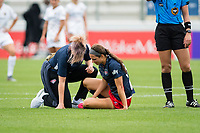 CARY, NC - APRIL 10: Ashley Hatch #33 of the Washington Spirit receives treatment from Washington Spirit athletic trainer Jess Trapp during a game between Washington Spirit and North Carolina Courage at Sahlen's Stadium at WakeMed Soccer Park on April 10, 2021 in Cary, North Carolina.