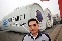 CHINA. Hebei.  Ji Yaotao, manager of the United Power factory producing wind turbines in Baoding City near Beijing, the world's first 'carbon positive' town. The town's main industires focus on producing wind and solar technologies. 2009