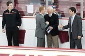Kevin Pratt (BC - Student Manager), Greg Brown (BC - Associate Head Coach), Jerry York (BC - Head Coach), Mike Ayers (BC - Assistant Coach) - The Boston College Eagles defeated the visiting University of Wisconsin Badgers 9-2 on Friday, October 18, 2013, at Kelley Rink in Conte Forum in Chestnut Hill, Massachusetts.