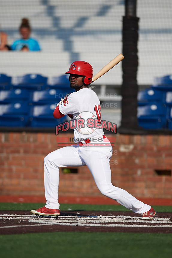 Johnson City Cardinals left fielder Luis Flores (16) follows through on a swing during a game against the Danville Braves on July 29, 2018 at TVA Credit Union Ballpark in Johnson City, Tennessee.  Johnson City defeated Danville 8-1.  (Mike Janes/Four Seam Images)