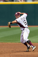 Texas A&M Aggies shortstop Mikey Reynolds (16) prepares to make a throw to first base against the LSU Tigers in the NCAA Southeastern Conference baseball game on May 11, 2013 at Blue Bell Park in College Station, Texas. LSU defeated Texas A&M 2-1 in extra innings to capture the SEC West Championship. (Andrew Woolley/Four Seam Images).