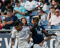 FOXBOROUGH, MA - JULY 27: Tesho Akindele #13 and Wilfried Zahibo #23 battle for head ball during a game between Orlando City SC and New England Revolution at Gillette Stadium on July 27, 2019 in Foxborough, Massachusetts.