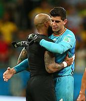 Belgium goalkeeper Thibaut Courtois hugs USA goalkeeper Tim Howard at full time