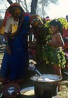 INDIA Karnataka, every year a festival takes place around the Yellamma temple in Saundatti and attracts thousand of pilgrims from villages, here is also practizised the Devadasi cult, where young girls are secretly dedicated to the hindu goddess Yellamma, most of the girls end in prostitution, young girl is dressed up in neem leaves for the ceremony  / INDIEN Karnataka, jedes Jahr findet in Saundatti das Tempelfest zu Ehren der Goettin Yellamma statt, das Tausende Pilger aus den umliegenden Doerfern anzieht, hier wird der Devadasi Klt praktiziert, heimlich werden junge Maedchen der Hindu Goettin Yellamma geweiht, die Maedchen enden spaeter meistens in der Prostitution, junges Maedchen in einem Kleid aus Niem Blaettern