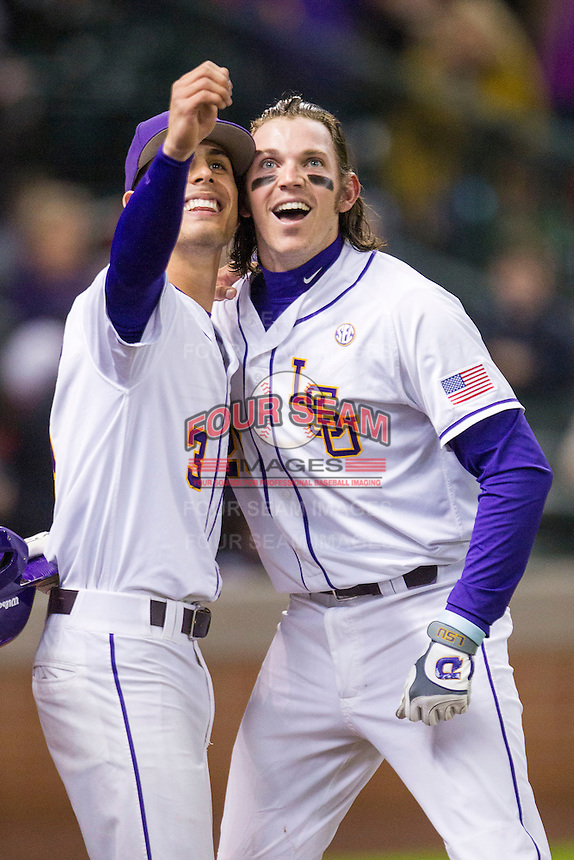 "LSU Tigers third baseman Conner Hale (20) celebrates by mimicking taking a ""selfie"" with Kramer Robertson (3) after belting a 2 run home run during the NCAA baseball game against the Houston Cougars on March 6, 2015 at Minute Maid Park in Houston, Texas. LSU defeated Houston 4-2. (Andrew Woolley/Four Seam Images)"