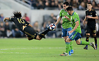 LOS ANGELES, CA - OCTOBER 29: Carlos Vela #10 of the Los Angeles FC fly's through the air during a game between Seattle Sounders FC and Los Angeles FC at Banc of California Stadium on October 29, 2019 in Los Angeles, California.