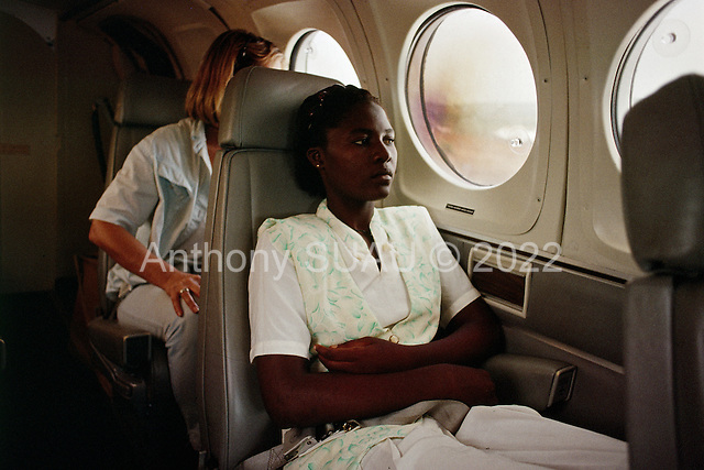 Conakry, Guinea<br /> April 2001<br /> <br /> Jalikaou Tity Turay, 18, with her sister, in an International Red Cross (ICRC) plane from Conakry, Guinea to Freetown, Sierra Leone to be reunited with her mother after 3 years in Guinea as refugees.