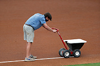 Tennessee Smokies grounds crew prepares the field prior to the game against the Biloxi Shuckers on May 18, 2021, at Smokies Stadium in Kodak, Tennessee. (Danny Parker/Four Seam Images)