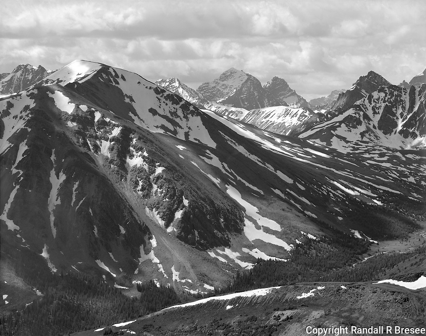 """""""Atop The Jasper Tram"""" <br /> Jasper National Park; Alberta, Canada<br /> <br /> A ride up the tramway near the town of Jasper provides easy access to spectacular vistas from an elevation above 7,500 feet. I captured this photo only a short distance from the terminal building of the tram. A dark yellow filter was used to reduce atmospheric haze and help the mountains feel more """"solid"""" in the photograph."""
