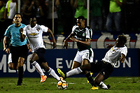 PALMIRA - COLOMBIA, 19-09-2018: Jhon Mosquera (Cent.) jugador de Deportivo Cali disputa el balón Christian Cruz (Izq.) y Edison Realpe (Der.) jugadores de Liga Deportiva Universitaria de Quito, durante partido entre Deportivo Cali (COL) y Liga Deportiva Universitaria de Quito (ECU), de los octavos de final, llave H, por la Copa Conmebol Sudamericana 2018, jugado en el estadio Deportivo Cali (Palmaseca) en la ciudad de Palmira. / Jhon Mosquera (C) player of Deportivo Cali vies for the ball with Christian Cruz (L) and Edison Realpe (R) players of Liga Deportiva Universitaria de Quito, during a match between Deportivo Cali (COL) and Liga Deportiva Universitaria de Quito (ECU), of eighth finals, key H, for the Copa Conmebol Sudamericana 2018, at the Deportivo Cali (Palmaseca) stadium in Palmira city. Photo: VizzorImage  / Luis Ramirez / Staff.
