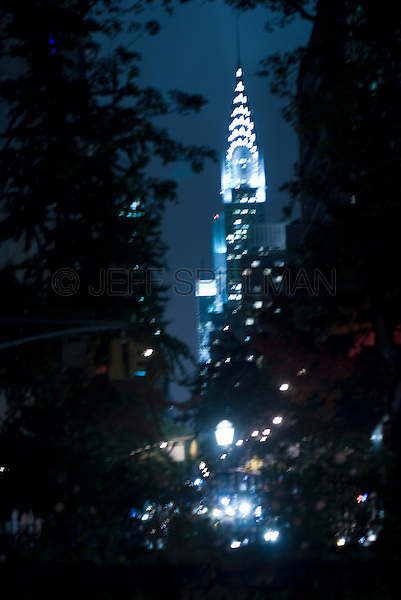 Blurred Motion View of the Chrysler Building, Seen thru trees in Gramercy Park, New York City, New York State, USA