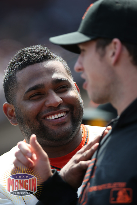 SAN FRANCISCO, CA - MAY 8:  Pablo Sandoval #48 of the San Francisco Giants jokes around with teammate Buster Posey #28 in the dugout during the game against the Philadelphia Phillies at AT&T Park on Wednesday, May 8, 2013 in San Francisco, California. Photo by Brad Mangin