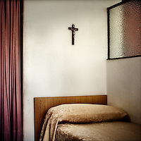 A crucifix hangs on the wall above a bed in a bedroom of a priest at the Legionaries of Christ seminary in Salamanca. The rooms are small and separated only by a glass partition which doesn't reach the ceiling, so there is little privacy. The Legion of Christ is a conservative Roman Catholic congregation whose members take vows of chastity, obedience and poverty.