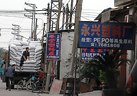 Mai Village in the shunde diatrict is a major producer of plastic pellets from waste plastic rubbish, including carrier bags and other plastic waste much originating from Europe.  Carrier bags from the British supermarket chain Tesco, and also Argos and Help the aged contribute to horrendous pollution in the Shunde district of Guangdong, China.  Italian, Dutch and British waste was found to being re-cycled in the area.<br /> Photo by Richard Jones / Sinopix