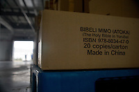 """Bibles printed in Yoruba, a west African tribal language, sit boxed in a warehouse ready for shipment from the Amity Printing Company's new printing facility in Nanjing, China.  The boxes say """"Bibeli Mimo (Atoka) (The Holy Bible in Yoruba) Made in China.""""..On May 18, 2008, the Amity Printing Company in Nanjing, Jiangsu Province, China, inaugurated its new printing facility in southern Nanjing.  The facility doubles the printing capacity of the company, now up to 12 million Bibles produced in a year, making Amity Printing Company the largest producer of Bibles in the world.  The company, in cooperation with the international organization the United Bible Societies, produces Bibles for both domestic Chinese use and international distribution.  The company's Bibles are printed in Chinese and many other languages.  Within China, the Bibles are distributed both to registered and unregistered Christians who worship in illegal """"house churches."""""""
