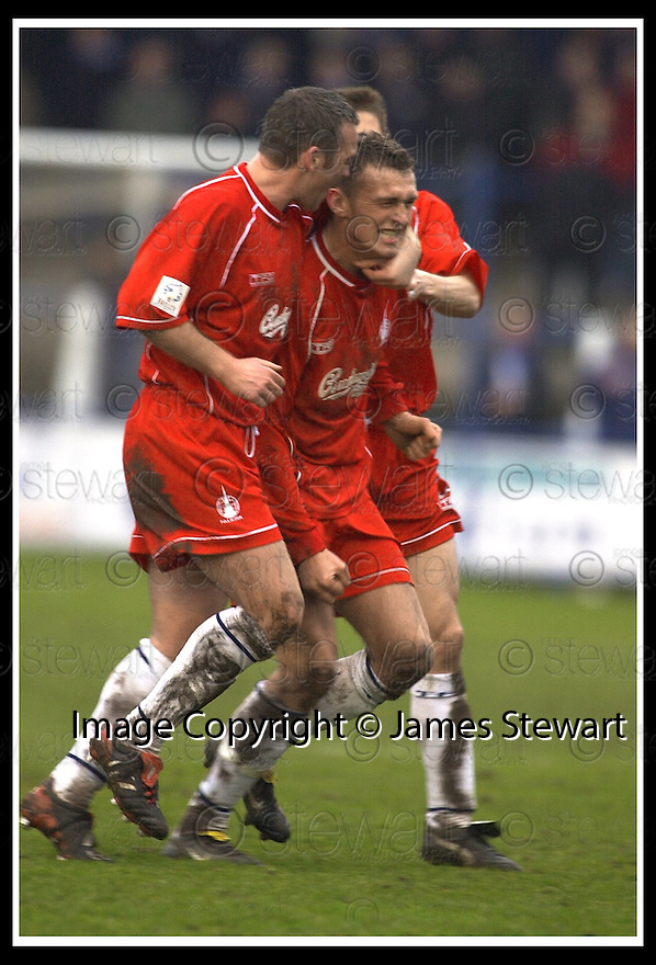 01/03/2003                   Copyright Pic : James Stewart.File Name : stewart-qots v falkirk 06.LEE MILLER IS CONGRATULATED BY DAVIE NICHOLL AFTER SCORING FALKIRK'S GOAL....James Stewart Photo Agency, 19 Carronlea Drive, Falkirk. FK2 8DN      Vat Reg No. 607 6932 25.Office     : +44 (0)1324 570906     .Mobile  : +44 (0)7721 416997.Fax         :  +44 (0)1324 570906.E-mail  :  jim@jspa.co.uk.If you require further information then contact Jim Stewart on any of the numbers above.........