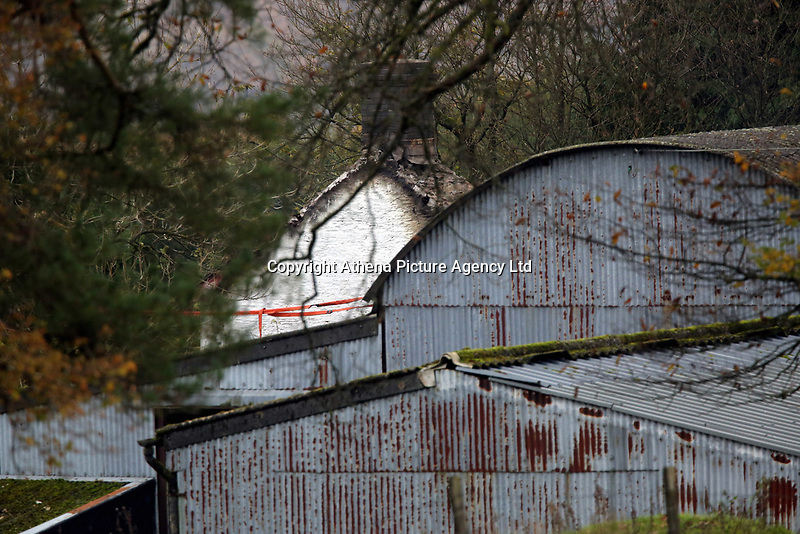 Pictured: A partial view of the house that burned in Llangammarch Wells, Powys, Wales, UK. Tuesday 31 October 2017<br />Re: Investigations continue into a house fire in which a father and several of his children have died.<br />Three children aged 13, 12 and 10 escaped the farmhouse in Llangammarch Wells, Powys, in the early hours of Monday and raised the alarm.<br />Police said they could not identify the deceased or confirm numbers.<br />One of those missing has been named locally as David Cuthbertson.