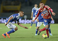 BOGOTÁ -COLOMBIA, 23-11-2013. Lewis Ochoa (Izq.) jugador de Millonarios disputa el balón con Osneider Alvarez (Der.) jugador de Deportivo Pasto durante partido por la fecha 3 de los cuadrangulares finales de la Liga Postobón  II 2013 jugado en el estadio Nemesio Camacho el Campín de la ciudad de Bogotá./ Lewis Ochoa (L) player of Millonarios fights for the ball with Osneider Alvarez (R) player of Deportivo Pasto during match for the 3rd date of final quadrangulars of the Postobon  League II 2013 played at Nemesio Camacho El Campin stadium in Bogotá city. Photo: VizzorImage/Gabriel Aponte/STR