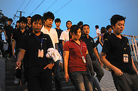 Foxconn workers make their way to work the night-shift at the mammoth Longhua plant, Shenzhen. Foxconn is Apple's major supplier and the Shenzhen plant employs 420,000 workers. There have been a rash of at leat 12 suicides in 2010 believed to be due to harsh management practices..