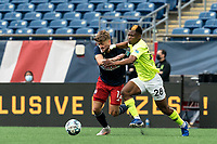 FOXBOROUGH, MA - MAY 12: Justin Rennicks #12 of New England Revolution II attempts to control the ball as Illal Osumanu #28 of Union Omaha defends during a game between Union Omaha and New England Revolution II at Gillette Stadium on May 12, 2021 in Foxborough, Massachusetts.