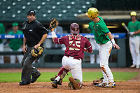 Florida State Seminoles catcher Cal Raleigh (35) shows the ball to home plate umpire Olindo Mattia after tagging out Jake Shepski (0) of the Notre Dame Fighting Irish during Game Four of the 2017 ACC Baseball Championship at Louisville Slugger Field on May 24, 2017 in Louisville, Kentucky.  The Seminoles walked-off the Fighting Irish 5-3 in 12 innings. (Brian Westerholt/Four Seam Images)