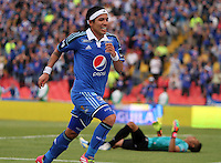 BOGOTA -COLOMBIA. 29-03-2014. Dayro Moreno de Millonarios   celebra su gol contra Patriotas de Boyaca F.C. partido por la treceava  fecha de La liga Postobon 1 disputado en el estadio Nemesio Camacho El Campin. /   Dayro Moreno  of Millonarios  celebrates his goal  against Patriotas de Boyaca F.C.  during the match for the thirteenth round of The Postobon one league match at Nemesio Camacho El Campin  Stadium . Photo: VizzorImage/ Felipe Caicedo / Staff