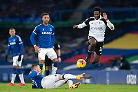 14th February 2021, Doddison Park, Liverpool, England;  Fulhams Ola Aina fights for the ball against Evertons Gylfi Sigurdsson Bottom during the Premier League match between Everton and Fulham at Goodison Park in Liverpool