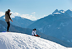 Italy, Alto Adige (South Tyrol), Maranza: mother with child sledging