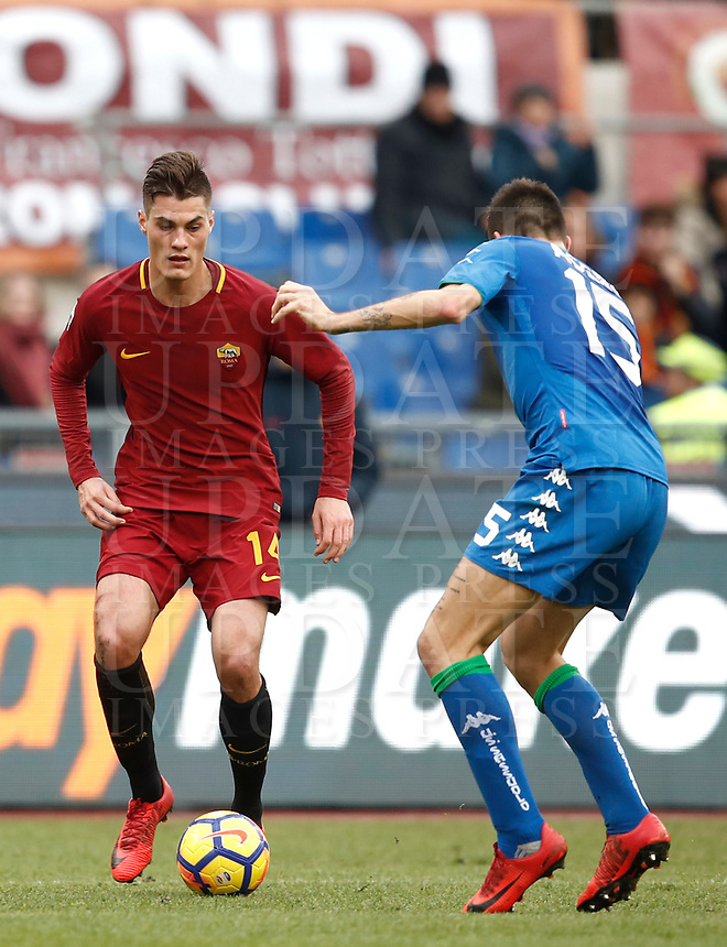 Calcio, Serie A: AS Roma - Sassuolo, Roma, stadio Olimpico, 30 dicembre 2017.<br /> Roma's Patrik Schick (l) in action with Sassuolo's Francesco Acerbi (r) during the Italian Serie A football match between AS Roma and Sassuolo at Rome's Olympic stadium, 30 December 2017.<br /> UPDATE IMAGES PRESS/Isabella Bonotto