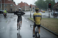 Marco Coledan (ITA/Trek Factory Racing) putting on his rain jacket while still riding (neutralised) to the actual race start<br /> <br /> stage 5: Eindhoven - Boxtel (183km)<br /> 29th Ster ZLM Tour 2015