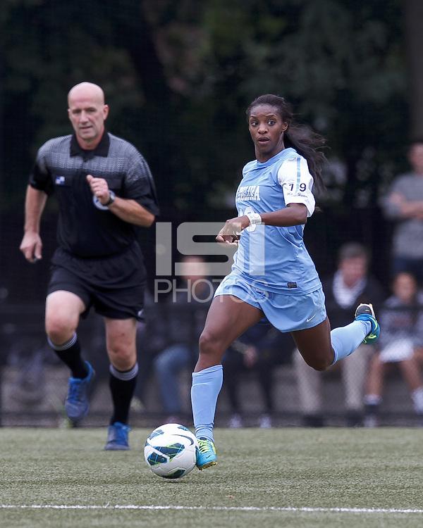 University of North Carolina midfielder Crystal Dunn (19) brings the ball forward.   University of North Carolina (blue) defeated Boston College (white), 1-0, at Newton Campus Field, on October 13, 2013.