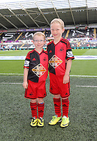 Pictured: Children mascots. Saturday 23 August 2014<br /> Re: Premier League, Swansea City FC v Burnley at the Liberty Stadium, south Wales