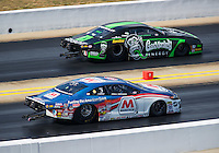 Sep 17, 2016; Concord, NC, USA; NHRA pro stock driver Allen Johnson (near) races alongside Alex Laughlin during qualifying for the Carolina Nationals at zMax Dragway. Mandatory Credit: Mark J. Rebilas-USA TODAY Sports