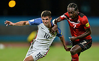 Couva, Trinidad & Tobago - Tuesday Oct. 10, 2017: Christian Pulisic, Nathan Lewis during a 2018 FIFA World Cup Qualifier between the men's national teams of the United States (USA) and Trinidad & Tobago (TRI) at Ato Boldon Stadium.