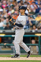 Jorge Posada #20 of the New York Yankees warms up the pitcher between innings at Comerica Park April 27, 2009 in Detroit, Michigan.  Photo by Brian Westerholt / Four Seam Images