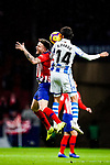Saul Niguez of Atletico de Madrid (L) fights for the ball with Ruben Pardo of Real Sociedad (R) during the La Liga 2018-19 match between Atletico de Madrid and Real Sociedad at Wanda Metropolitano on October 27 2018 in Madrid, Spain.  Photo by Diego Souto / Power Sport Images