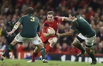 Wales wing George North tries to beat Springbok pair Frans Malherbe and Willem Alberts.<br /> <br /> 2013 Dove Men Series<br /> Wales v South Africa<br /> Millennium Stadium<br /> 09.11.13<br /> ©Steve Pope-Sportingwales