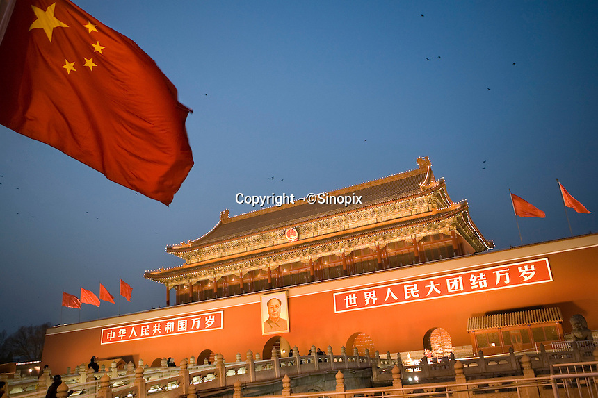 A portrait of Chairman Mao above Tiananmen gate at the entrance to the forbidden city in Beijing, China..Dec 2006