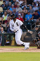 AFL West designated hitter Luis Robert (20), of the Glendale Desert Dogs and Chicago White Sox organization, releases his bat as he starts down the first base line during the Arizona Fall League Fall Stars game at Surprise Stadium on November 3, 2018 in Surprise, Arizona. The AFL West defeated the AFL East 7-6 . (Zachary Lucy/Four Seam Images)