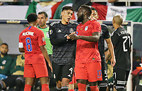 CHICAGO, ILLINOIS - JULY 07: Edson Álvarez #4, Jozy Altidore #17 during the 2019 CONCACAF Gold Cup Final match between the United States and Mexico at Soldier Field on July 07, 2019 in Chicago, Illinois.