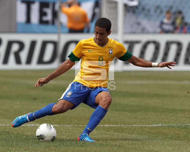 Brazil midfielder Romulo (8) passes the ball. In an international friendly (Clash of Titans), Argentina defeated Brazil, 4-3, at MetLife Stadium on June 9, 2012.