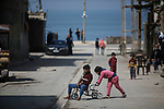 Children play in the beach camp beside the beach in  Gaza City 16 March, 2020. Photo by Osama Baba