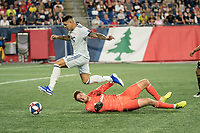 FOXBOROUGH, MA - AUGUST 4: Gustavo Bao #7 of New England Revolution passes Tyler Miller #1 of Los Angeles FC near the Los Angeles FC goal during a game between Los Angeles FC and New England Revolution at Gillette Stadium on August 3, 2019 in Foxborough, Massachusetts.