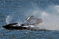 """Frame 1: Jay Gignac, GNH-55 """"Gi Wizz"""" returns to the pits with the left sponson blown out and damage to the right.  (Grand National Hydroplane(s)"""