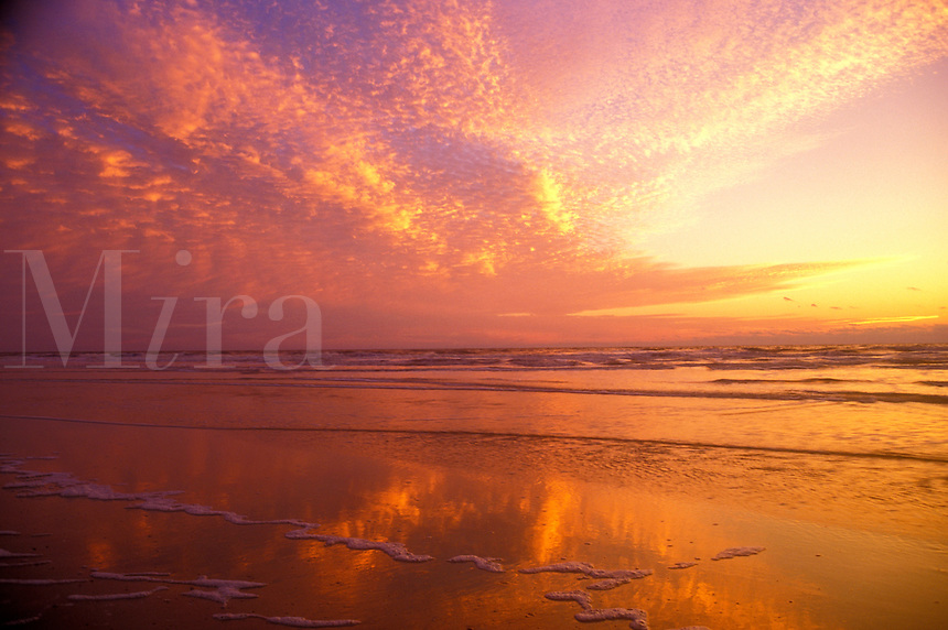 AJ1561, sunrise, sunset, Cumberland Island, Georgia, ocean, Clouds reflect on the calm waters along the beach at sunrise on Cumberland Island National Seashore, Georgia.