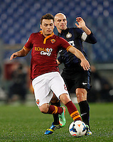 Calcio, Serie A: Roma vs Inter. Roma, stadio Olimpico, 1 marzo 2014.<br /> AS Roma forward Adem Ljajic, of Serbia, is challenged by FC Inter midfielder Esteban Cambiasso, of Argentina, during the Italian Serie A football match between AS Roma and FC Inter at Rome's Olympic stadium, 1 March 2014.<br /> UPDATE IMAGES PRESS/Riccardo De Luca